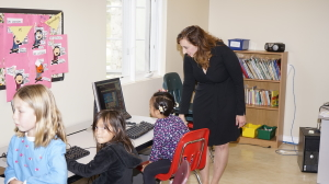Monica with girls in Girls Inc. Goleta computer room